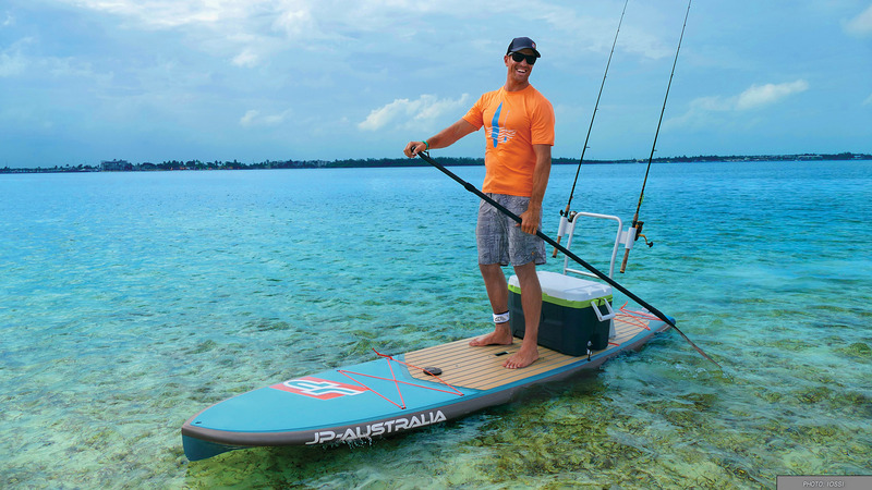 Happy man on fishing SUP