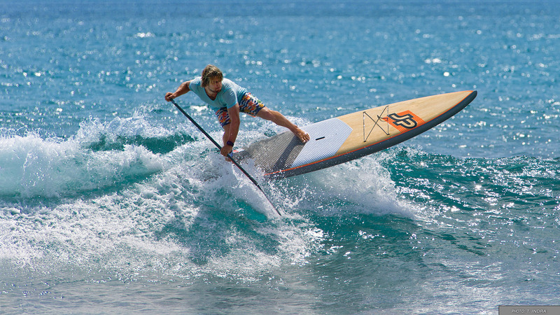 man on jp hybrid sup board surfing